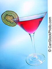 Party Cocktail - Red cocktail with kiwi garnish with blue...