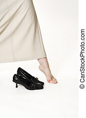 woman bare foot over white