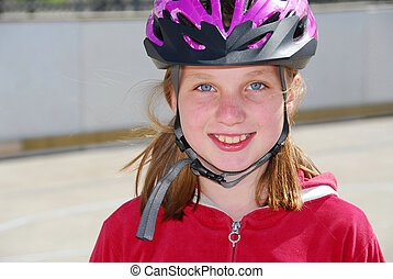 Girl child helmet - Portrait of a young girl rolleblading in...