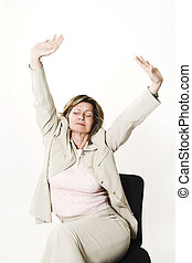 business woman stretching on chair over white