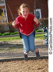 Girl on swings - Young girl on swings