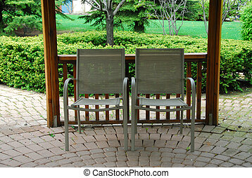 Two patio chairs - Two empty patio chairs