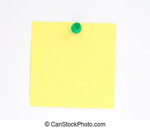 post-it note pinned to white paper wall