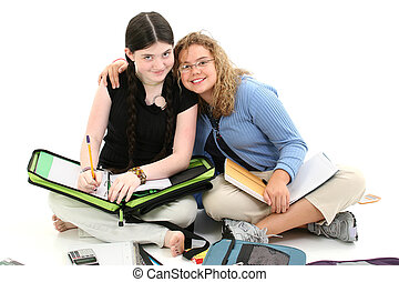 School Buddies - Two twelve year old girls doing homework...