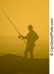 The Fisherman 2 - silhouette of a fisherman against a bright...