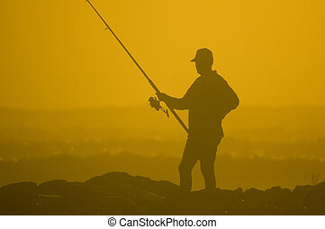 The Fisherman - silhouette of a fisherman against a bright...