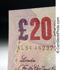 Close-up of twenty pound note on grad background