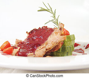 Pork chops with cranberry sauce and zuccini