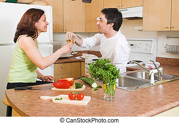couple in the kitchen cheering