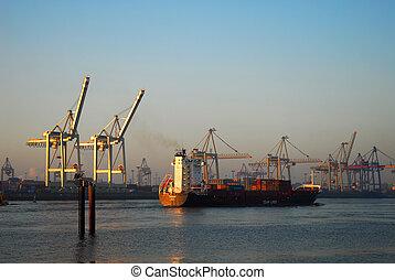 Bon voyage - Cargo ship is leaving Hamburg harbour.