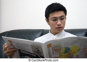 Young Asian Entrepreneur Reading Newspaper