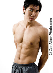 Muscular - The toned body of a young chinese man