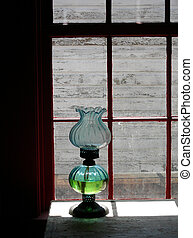 Pioneer Lighting - Antique oil lamp in western pioneer log...