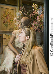 woman window shopping for clothes