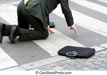 Businessman falling in the street on a crossing passage...