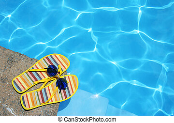 Shoes By Pool - Bright Flip-flops and sunglasses by swimming...