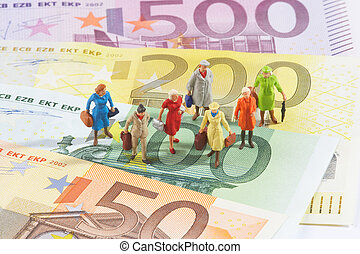 finacial business - plastic figures on papermoney