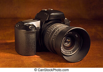 SLR camera - A 35mm SLR camera with standard zoom lens