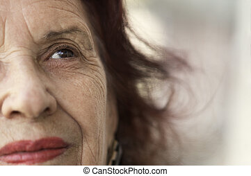 smile of the old age - old lady-focus on the eye