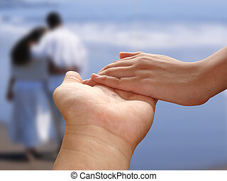 Holding Hands - Male and female holding hands