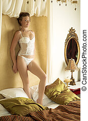 Lingerie263 - Woman in underwear standing on a bed