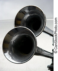 Two Horns - Two old fashioned air horns on an automobile