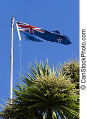 New Zealand Flag - The flag of New Zealand flying over...