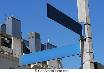 Show Me The Way To Go - A blank street sign with buildings...