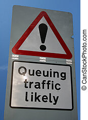 warning queuing traffic likely ahead sign