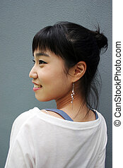 Attractive young Korean woman with her head turned