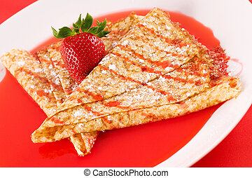 Crepes with fresh strawberry and syrup