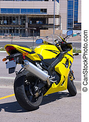 Yellow Motorcycle parked by the Construction - Yellos sports...