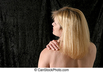 Back Pain - beautiful blonde woman rubbing and massaging her...