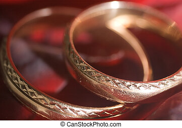 red roses - two red roses and wedding rings