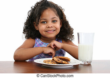 Milk and Cookies - Beautiful three-year-old African American...