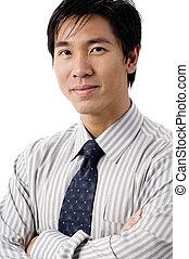 Confident Businessman - A confident asian businessman on...