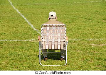 Sideline - Old Man Sitting on the Sideline