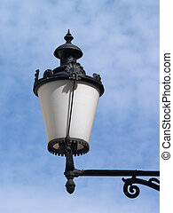 Street light on blue sky background