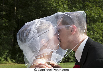 Bride and Groom Kiss - close-up of bride and groom