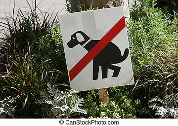 No Poop Sign - A sign warns dog owners to keep dogs from...