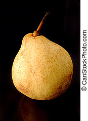 Yellow Chinese pear on black background