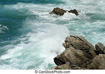 Rocky Surf - Surf rolling into rocks on the East Coast of...