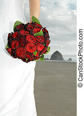 Brides bouquet - Bride holding bouquet on beach