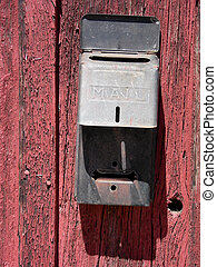 Barn Wood Mail Box - Old US Mail box on the side of a...