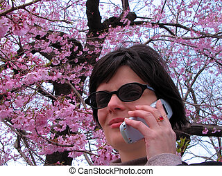 New communication season - Smiling woman with sunglasses and...