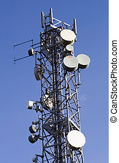Telecommunications mast and blue sky - Bright blue sky and...
