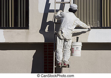 House Painter - A painter applies a fresh coat of paint.
