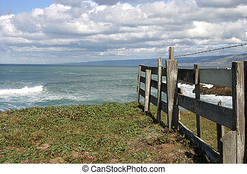 Lands End - A meadow and fence end abruptly as they meet the...