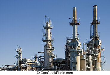 Oil Refinery 1 - The complex arrangement of metal pipes and...