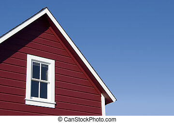 Red House Roof - A traditional looking red house roof.